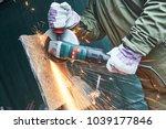 worker grinding cutting metal... | Shutterstock . vector #1039177846
