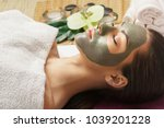 woman with clay facial mask in... | Shutterstock . vector #1039201228