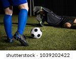 legs of a footballer player... | Shutterstock . vector #1039202422