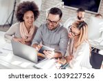 three confident business people ... | Shutterstock . vector #1039227526