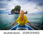 blonde woman on the edge of a... | Shutterstock . vector #1039255402