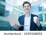 smiling man in suit with coffee ... | Shutterstock . vector #1039268002