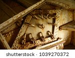 Small photo of Heavy closed scuttle inside of ancient warship.