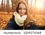 beautiful young girl with a... | Shutterstock . vector #1039274368