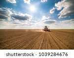 farmer seeding  sowing crops at ... | Shutterstock . vector #1039284676