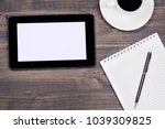 empty tablet and a cup of... | Shutterstock . vector #1039309825