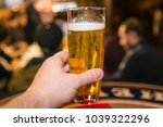 hand holding a beer | Shutterstock . vector #1039322296
