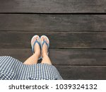blue shoes isolated on wood... | Shutterstock . vector #1039324132