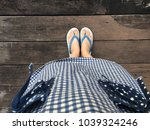 blue shoes isolated on wood... | Shutterstock . vector #1039324246
