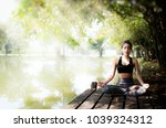 young women meditate while... | Shutterstock . vector #1039324312