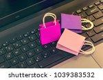 online shopping concept  three... | Shutterstock . vector #1039383532