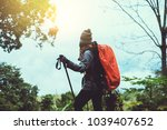 asian women travel  nature.... | Shutterstock . vector #1039407652