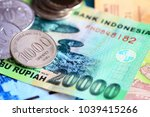 indonesian rupiah coins and... | Shutterstock . vector #1039415266