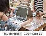 two beautiful freelance woman...   Shutterstock . vector #1039438612