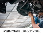 auto mechanic asian checking... | Shutterstock . vector #1039449208