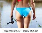 sexy woman fishing.  back view | Shutterstock . vector #103945652