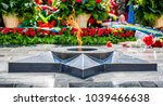laying flowers at the monument... | Shutterstock . vector #1039466638