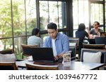 asian man working with laptop... | Shutterstock . vector #1039467772