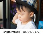 thai boy with the hat in the... | Shutterstock . vector #1039473172