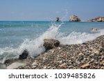 a wave on the beach near the... | Shutterstock . vector #1039485826