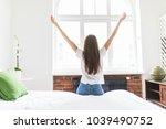woman standing near the window... | Shutterstock . vector #1039490752