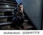 7 or 8 years old sad depressed... | Shutterstock . vector #1039497775