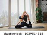 sports girl doing yoga at home... | Shutterstock . vector #1039514818