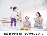 little asian girl jumpping on...   Shutterstock . vector #1039531996