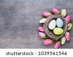 pink tulip with pink eggs nest... | Shutterstock . vector #1039561546