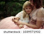 mom and daughter. mother's... | Shutterstock . vector #1039571932