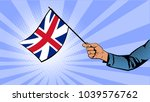 hand holds the flag of great... | Shutterstock .eps vector #1039576762