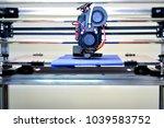 3d printer printing a model in... | Shutterstock . vector #1039583752