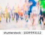 marathon runners in the city  | Shutterstock . vector #1039593112