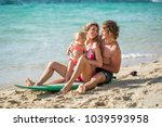 surfing. happy family sits on... | Shutterstock . vector #1039593958