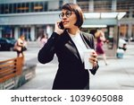 confident businesswoman in... | Shutterstock . vector #1039605088