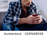 partial view of man with... | Shutterstock . vector #1039608538