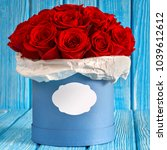 red roses flowers in a blue box ...   Shutterstock . vector #1039612612
