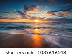 Sunrise over the sea and beautiful cloudscape. - stock photo