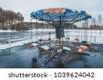 empty merry go round in winter  ...   Shutterstock . vector #1039624042