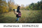 a girl in a coat with a... | Shutterstock . vector #1039625122