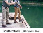 unrecognizable men with fishing ... | Shutterstock . vector #1039633162