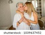 granddaughter kissing...   Shutterstock . vector #1039637452