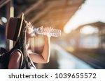 young woman back pack traveler... | Shutterstock . vector #1039655572