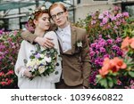stylish young groom and bride... | Shutterstock . vector #1039660822
