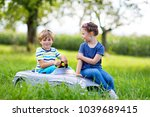 two happy children playing with ... | Shutterstock . vector #1039689415