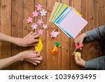 parent and child hand playing... | Shutterstock . vector #1039693495