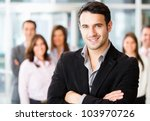 Successful man being leader of a business group - stock photo