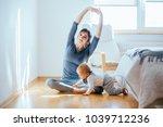 cute european mother doing yoga ... | Shutterstock . vector #1039712236