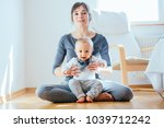 cute european sporty mother... | Shutterstock . vector #1039712242