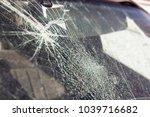 broken car window  an accident... | Shutterstock . vector #1039716682
